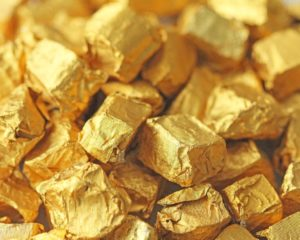 Gold Price Hits 7-Year High as Fed Scrambles to Curb Rate-Cut Mania